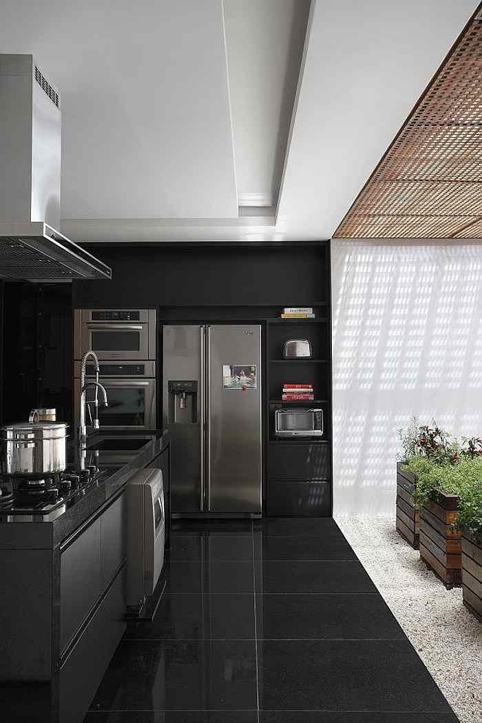 muebles minimalistas y plantas en la cocina